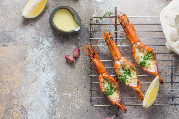 Grilled shrimps served with sauce and crusty bread - Stock Photo - Images