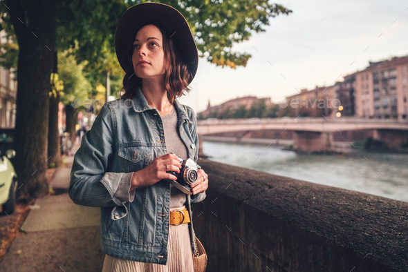Attractive girl with a camera in Italy - Stock Photo - Images