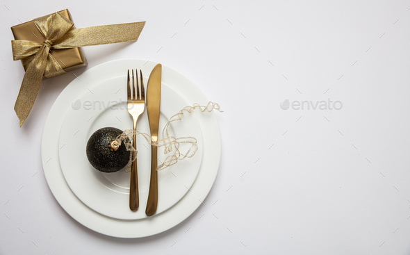 Table setting, xmas, new year. Gold cutlery on white set of dishes, white background - Stock Photo - Images