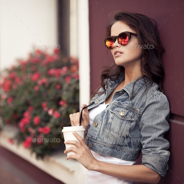 Young Woman Drinking Coffee From Paper Cup On A City Street - Stock Photo - Images