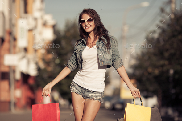 Young Happy Woman With Shopping Bags Walking On Street. - Stock Photo - Images