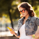 Young Woman Using Smartphone. City Park On Background. - PhotoDune Item for Sale