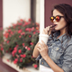 Young Woman Drinking Coffee From Paper Cup On A City Street - PhotoDune Item for Sale