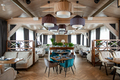 Interior of large hall of modern luxurious restaurant with served tables - PhotoDune Item for Sale