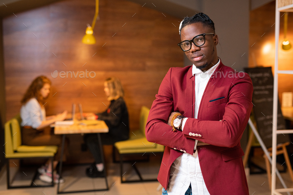 Stylish guy of African ethnicity in smart casual standing in front of camera - Stock Photo - Images