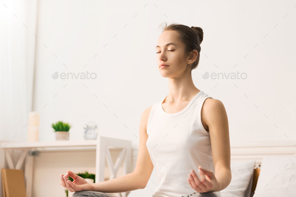 Calm morning. Woman doing yoga in lotus position - Stock Photo - Images