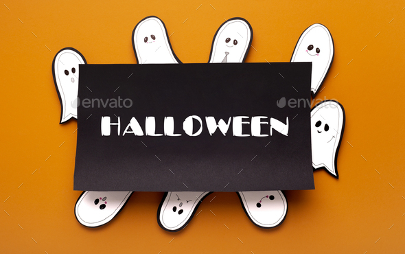 Paper cute ghost celebrating party around black frame - Stock Photo - Images