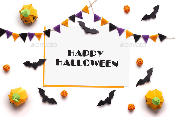 Happy Halloween text on white sheet of paper - Stock Photo - Images