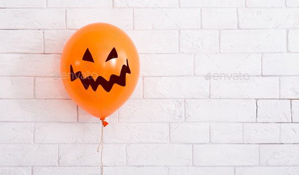 Conceptual Halloween balloon for party with scary smile - Stock Photo - Images