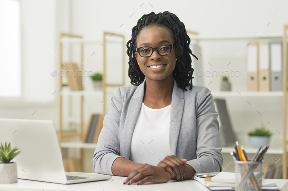 Afro Business Lady Smiling At Camera Sitting At Workplace - Stock Photo - Images