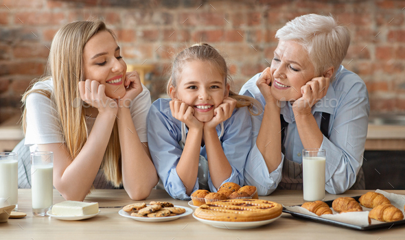 Happy loving family making bakery together at kitchen - Stock Photo - Images