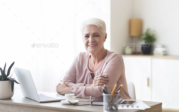 Successful happy aged lady working from home - Stock Photo - Images