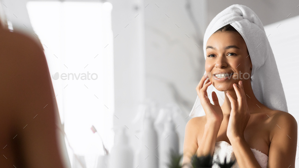 Afro Girl Touching Face Looking In Mirror In Bathroom. Panorama - Stock Photo - Images