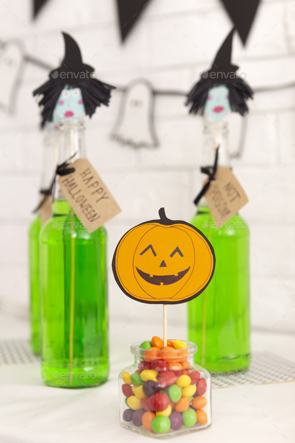 Happy Halloween party with green drinks and candies - Stock Photo - Images