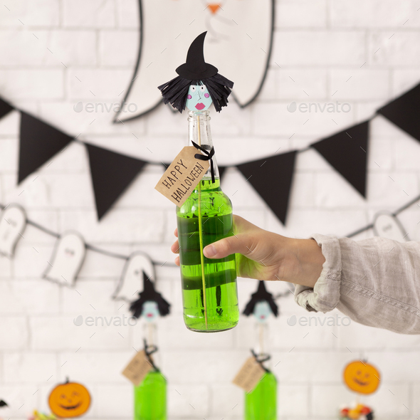 Close up of cute witches drink in woman hand - Stock Photo - Images