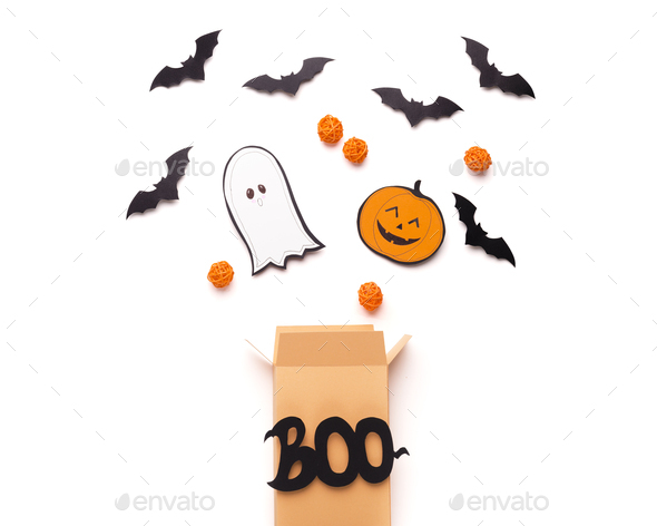 Open boo box with flying outside Candies, bats and ghosts - Stock Photo - Images