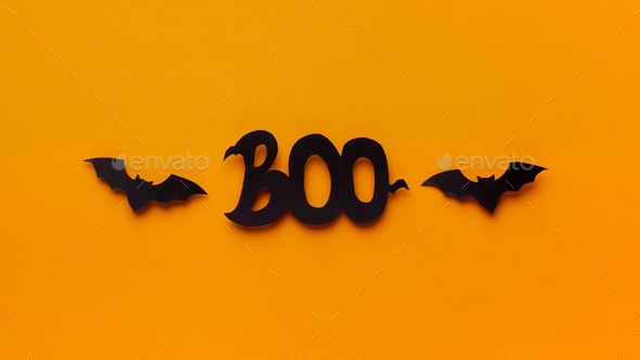 Boo text and two bats flying on orange background - Stock Photo - Images
