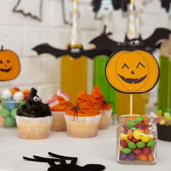 Halloween smiling and cute pumpkin suggesting candies - Stock Photo - Images