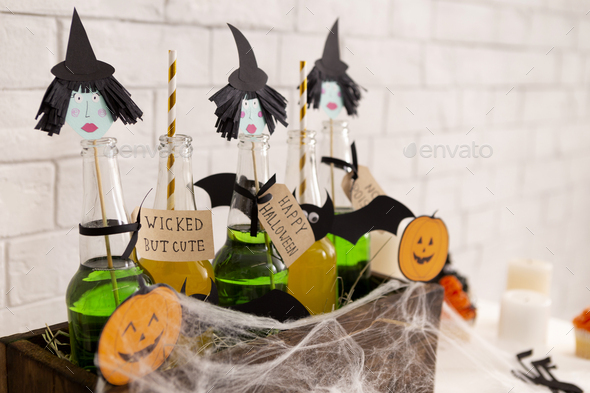 Different Halloween drinks with straws in wooden box - Stock Photo - Images