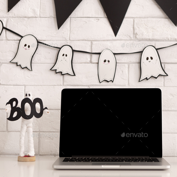 Modern laptop with black blank screen on white table - Stock Photo - Images