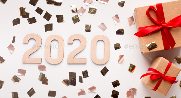 Wow 2020 New year concept with present boxes and gold confetti - Stock Photo - Images