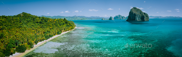 Panoramic drone aerial view of coastal scenery from the mainland Palawan with tropical Pinagbuyutan - Stock Photo - Images