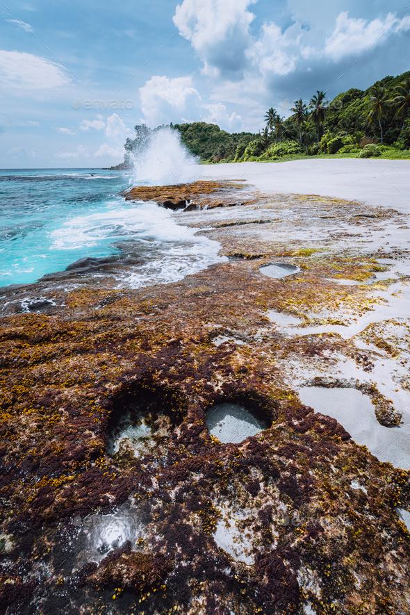 Breathtaking paradise beach Anse Bazarca. White sand, turquoise water, rough swell. Waves splashing - Stock Photo - Images