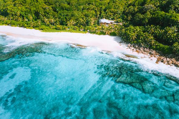 Aerial photo of bizarre paradise tropical beach Anse Bazarca at Mahe island, Seychelles. White sand - Stock Photo - Images