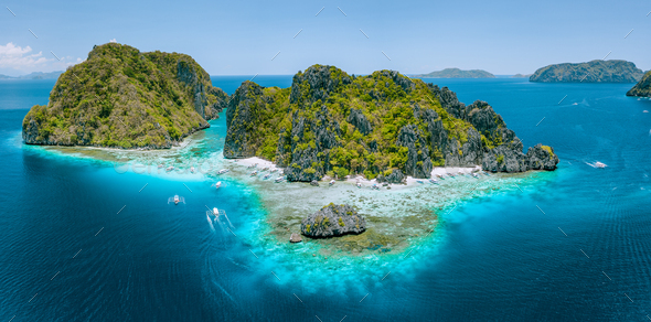 Aerial drone view of tropical Shimizu Island steep rocks and white sand beach in blue water El Nido - Stock Photo - Images