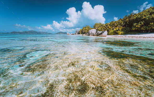 Anse Source d'Argent - Paradise beach with bizarre rocks and shallow lagoon on La Digue island - Stock Photo - Images