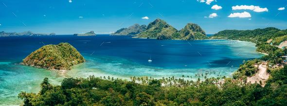 Aerial panoramic view of Las Cabanas beach and sea bay in El Nido, Palawan, Philippines - Stock Photo - Images