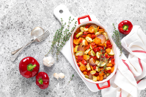Roasted vegetables. Carrot, zucchini, onion and red pepper oven baked with herbs. Top view - Stock Photo - Images