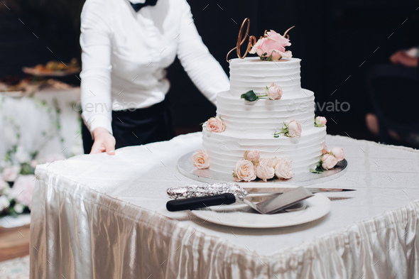 Beautiful wedding cake with flowers on table - Stock Photo - Images
