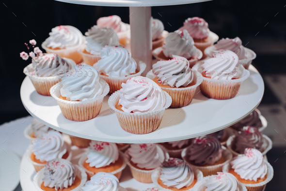 Delicious handmade cupcakes on layered display - Stock Photo - Images