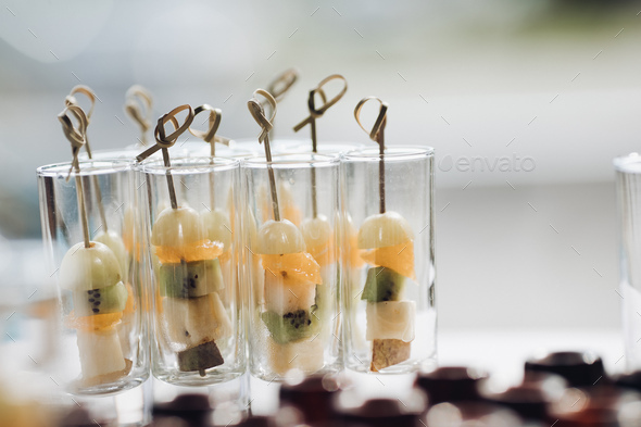 Delicious healthy fruit appetizers on celebration Concept of catering, desserts, arrangement and - Stock Photo - Images