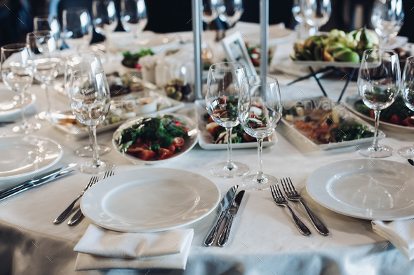 Served table with snacks and empty wine glasses - Stock Photo - Images