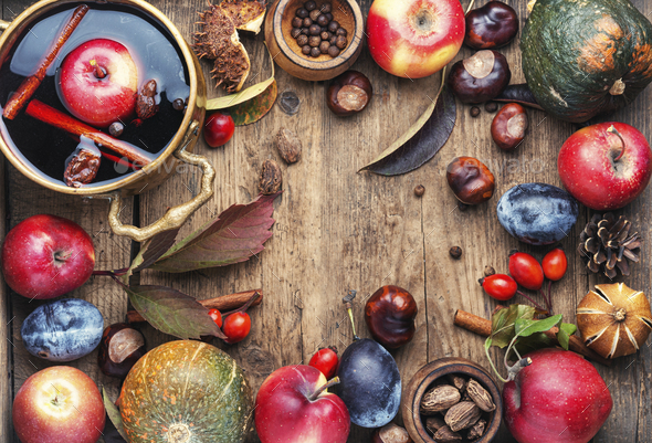 Mulled wine with autumn fruits - Stock Photo - Images