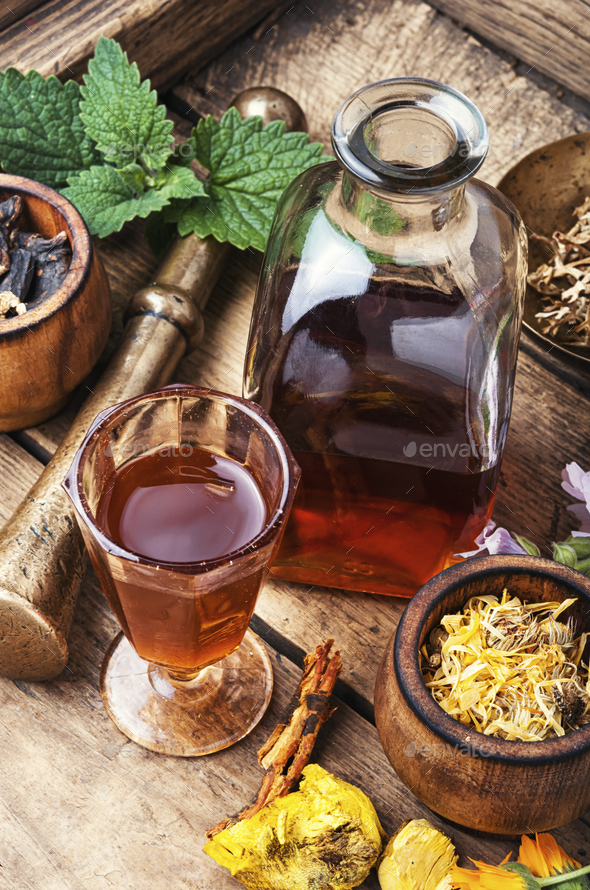 Healing herbs and bottle of elixir - Stock Photo - Images