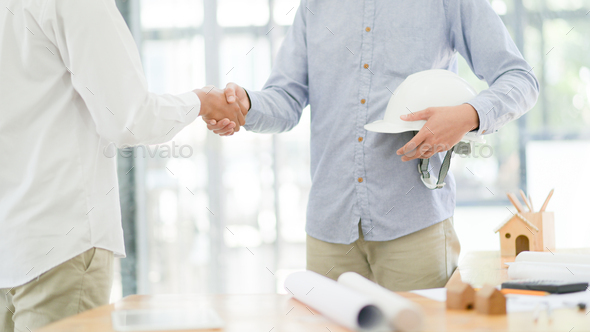 Architects and engineers hand in hand when the work is finished. - Stock Photo - Images