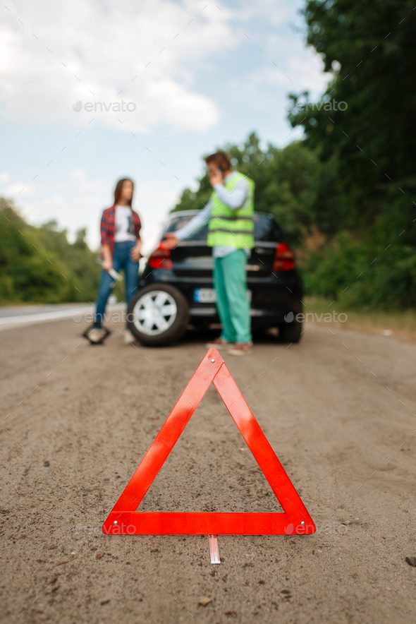 Emergency stop sign, flat tyre, punctured tire - Stock Photo - Images