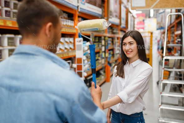 Young couple buying repair tools in hardware store - Stock Photo - Images