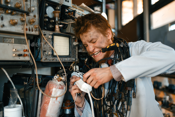 Crazy scientist conducting an experiment in lab - Stock Photo - Images