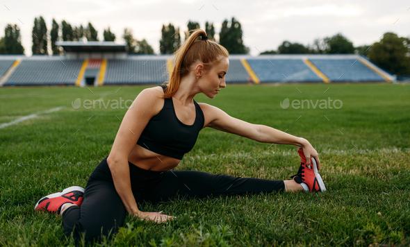 Female runner in sportswear, training on stadium - Stock Photo - Images