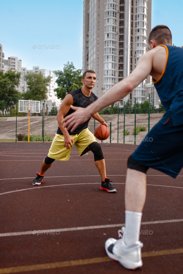 Two basketball players work out tactics outdoor - Stock Photo - Images