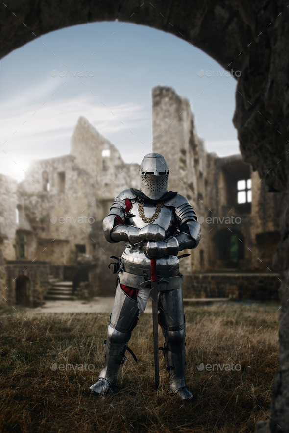 Knight in armor and helmet poses in castle - Stock Photo - Images