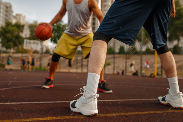 Two players in the center of basketball field - Stock Photo - Images
