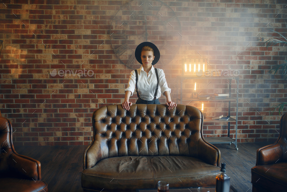 Woman in strict clothes and hat, gangster style - Stock Photo - Images