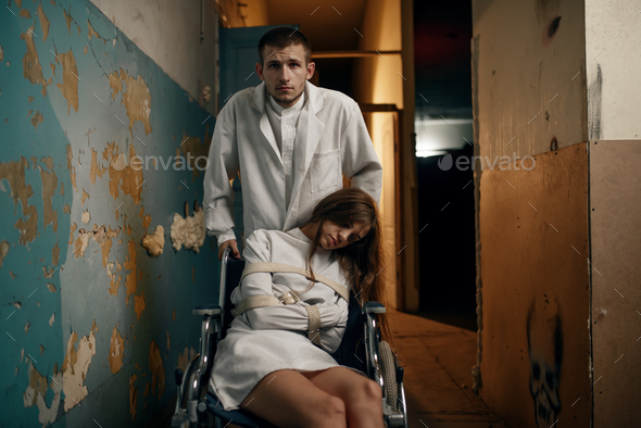 Male psychiatrist and female patient in wheelchair - Stock Photo - Images