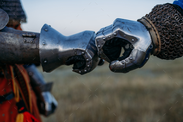 Medieval knights hands in metal gloves - Stock Photo - Images