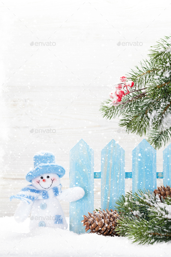 Christmas snowman toy and fir tree branch - Stock Photo - Images